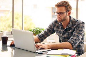 Man searching on laptop